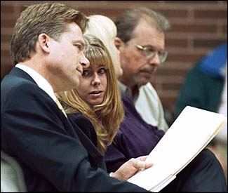 Tonya Harding converses with her lawyer.
